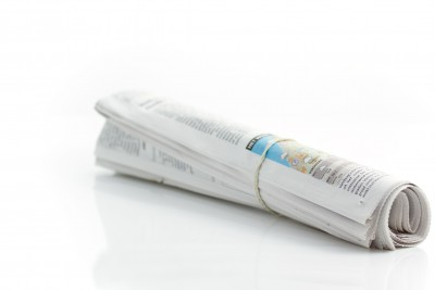 rolled newspaper