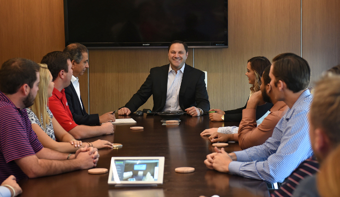 Mark Cerminaro at Head of Table at RapidAdvance for deBanked Magazine