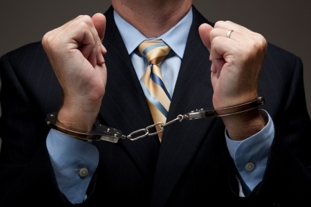 Sales Agent in Handcuffs
