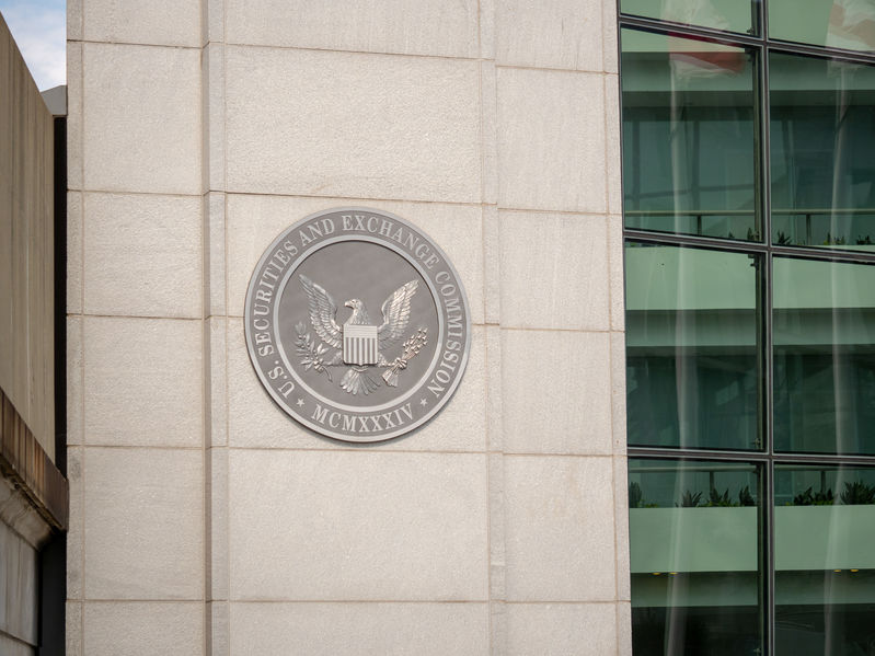 United States Securities and Exchange commission SEC logo on entrance of DC building near H street