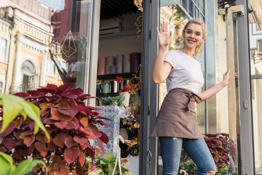 florist owner waving goodbye